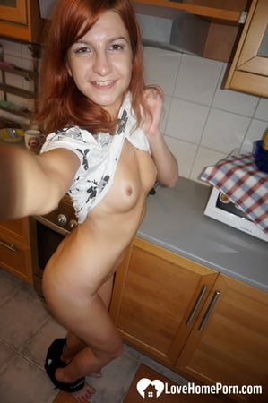 hot redhead tries on a sexy maid costume