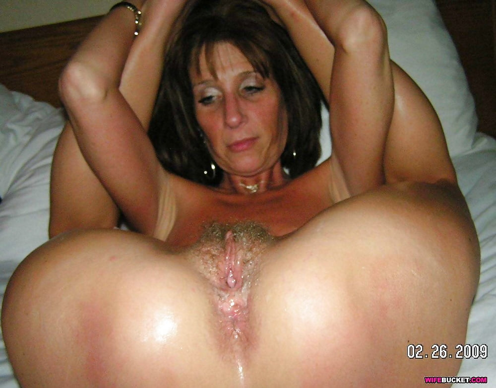 Mature fat brunette with enormous boobs