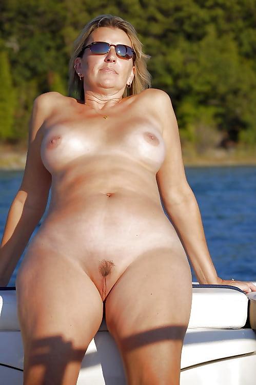 older-milf-shorts-boat-tide-up-naked-girl