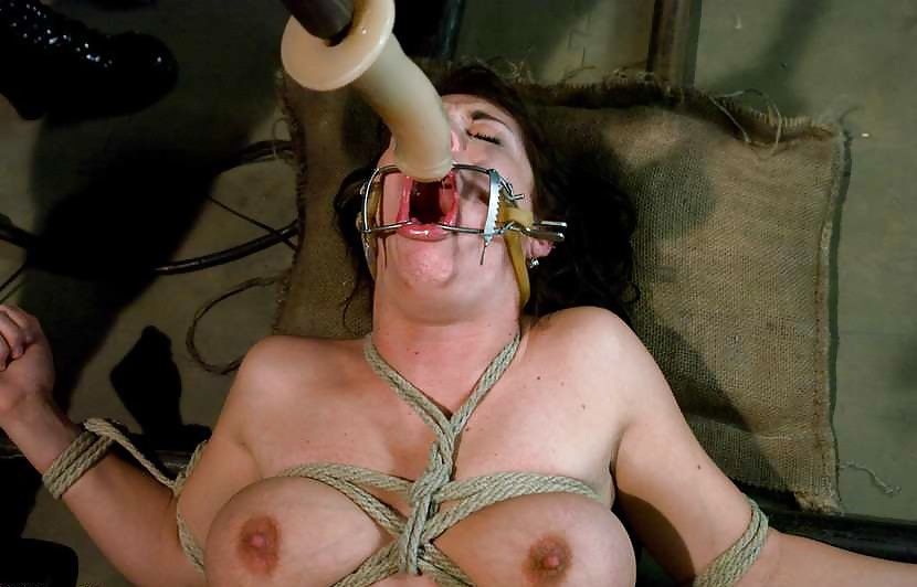 Butch Schoolgirl Pussy Caned In Rigid Metal Bondage