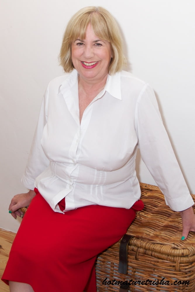 Nurse in grey skirt and white blouse