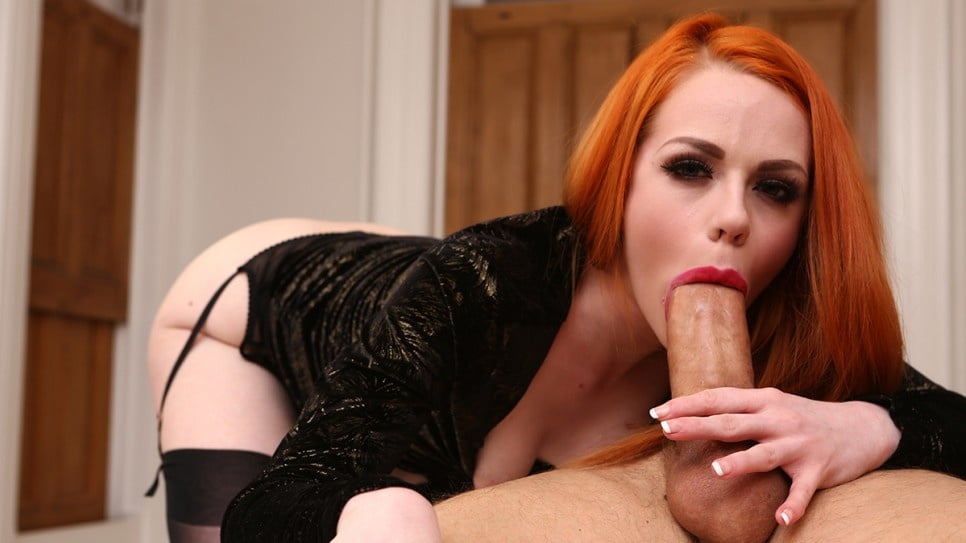 Girl with orange hair sucks cock