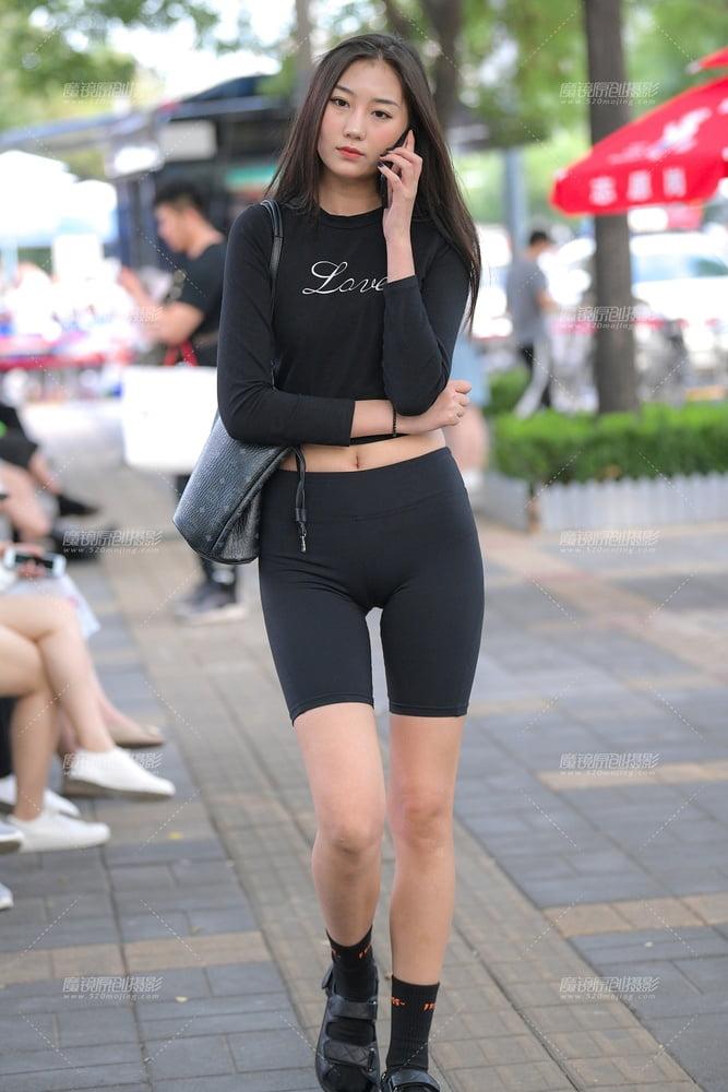 Slim tanned tight asian girls body stock photo