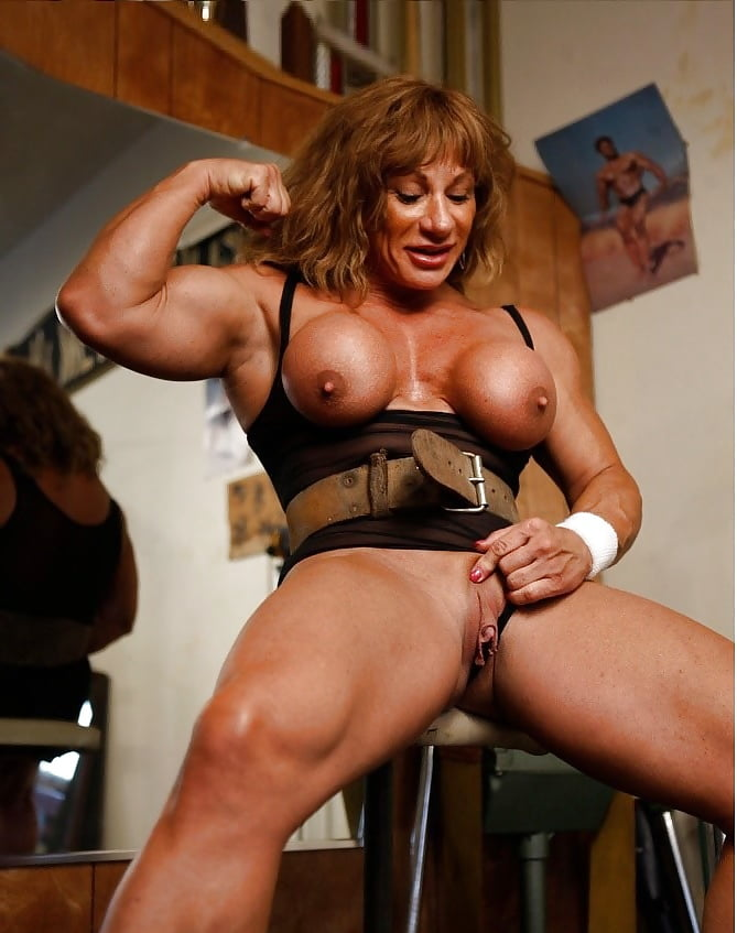 Woman flexing her arm muscles
