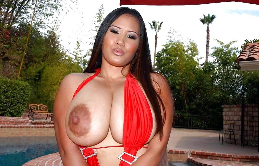 Стенкой порно китаянка с мега сисями сосет для