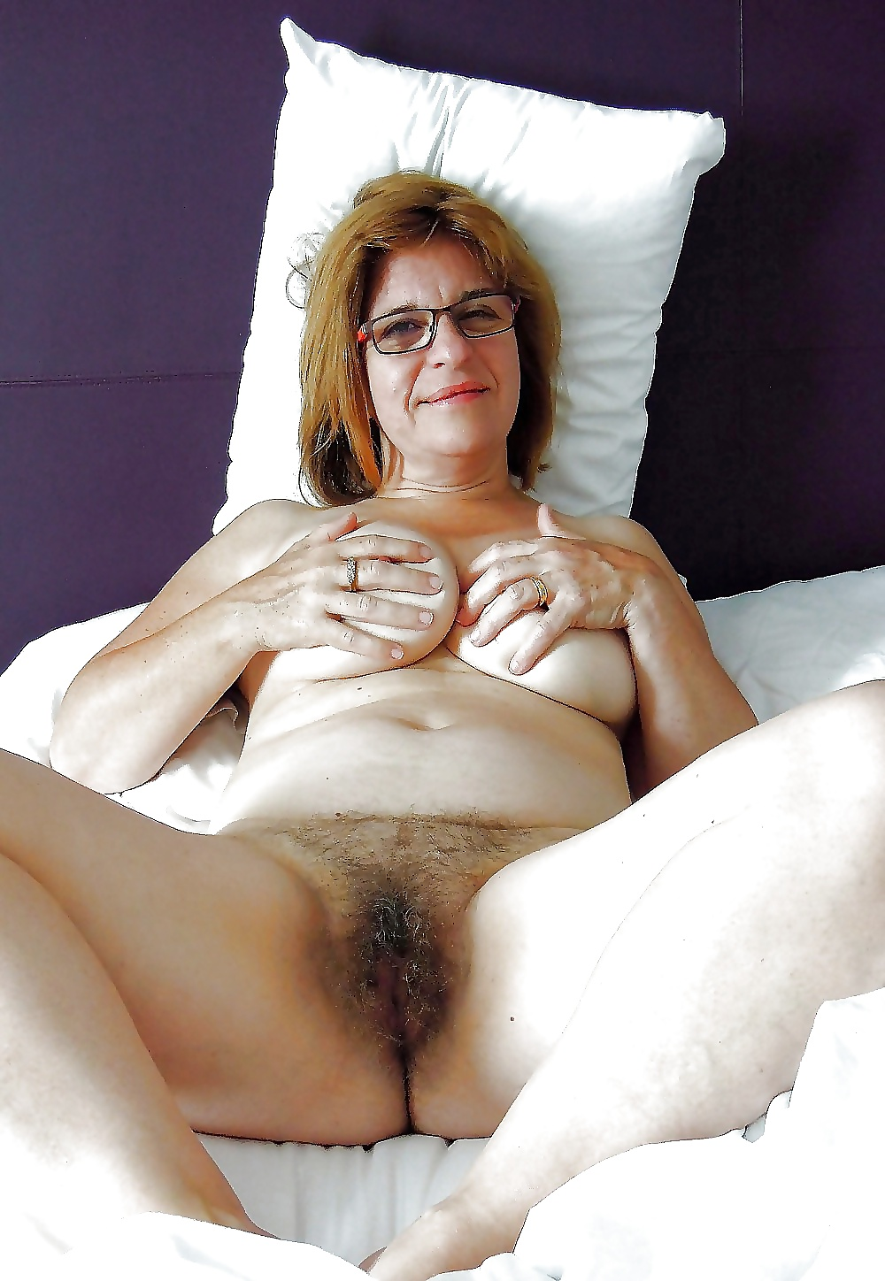 Full figured grandma shows her hairy and meaty hanging pussy