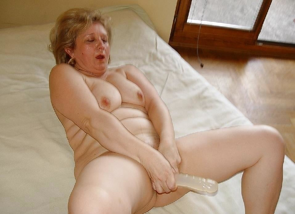 Mature granny masturbates and gets her hairy pussy rammed by a young cock