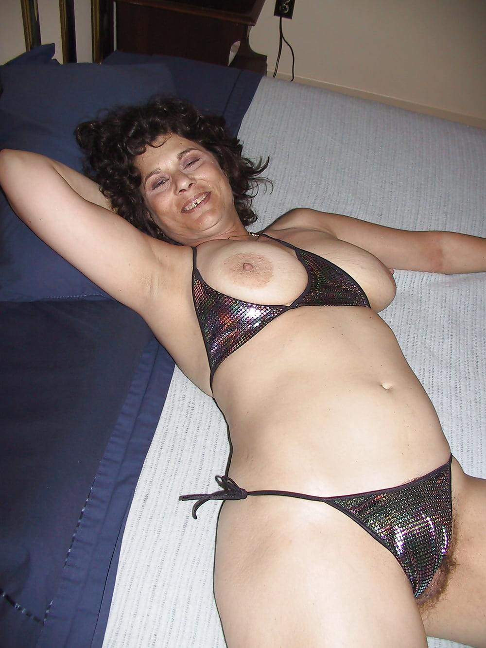 Masturbates with her clothes on