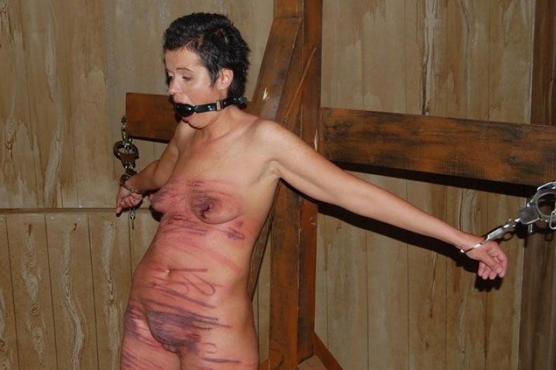 Men flogged naked spread eagle