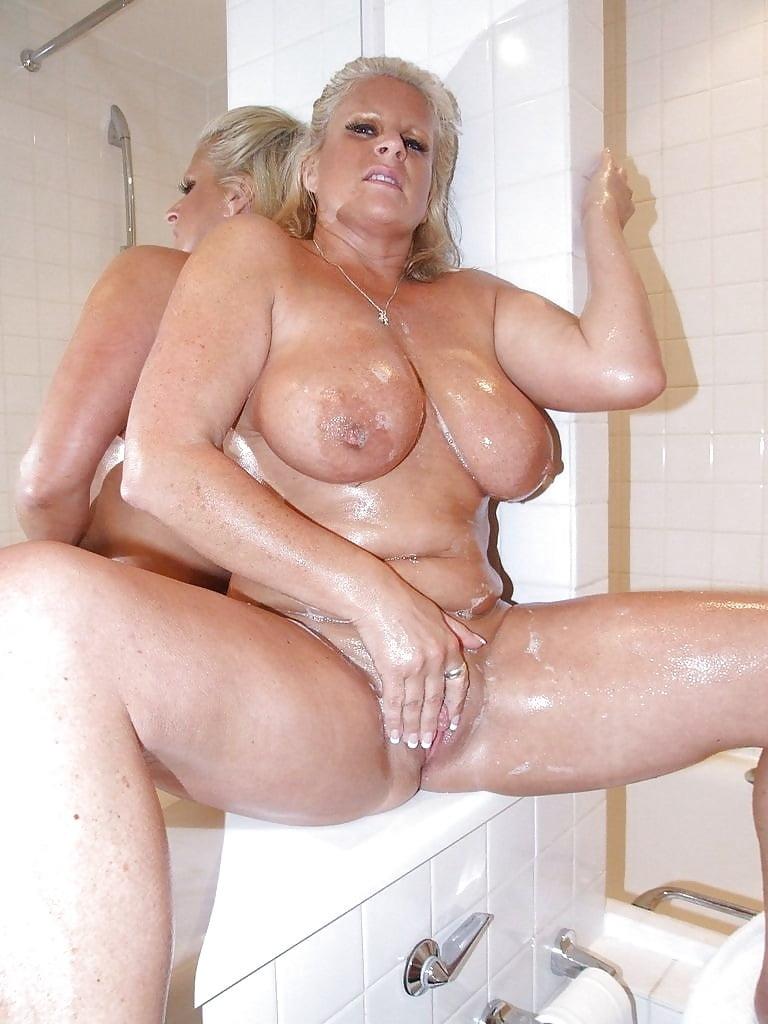 Man having a shower stock image