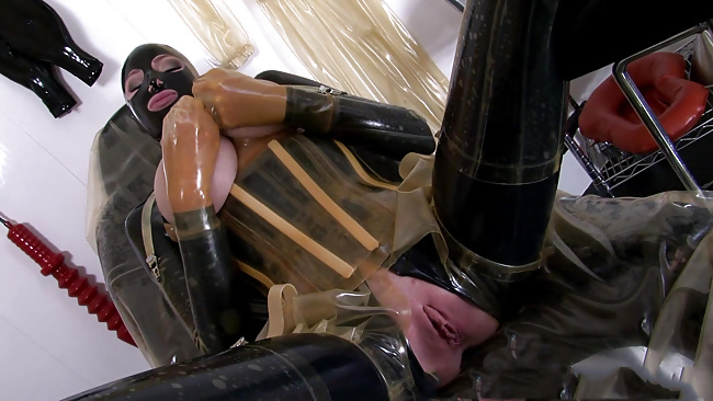 Watch perverted latex fun with a smoking hot pussy
