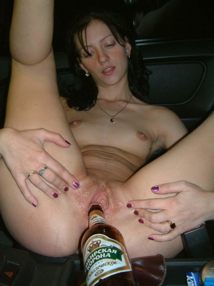 beer-bottle-in-her-pussy