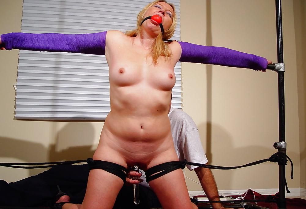 Girl on spreader bar nude 4
