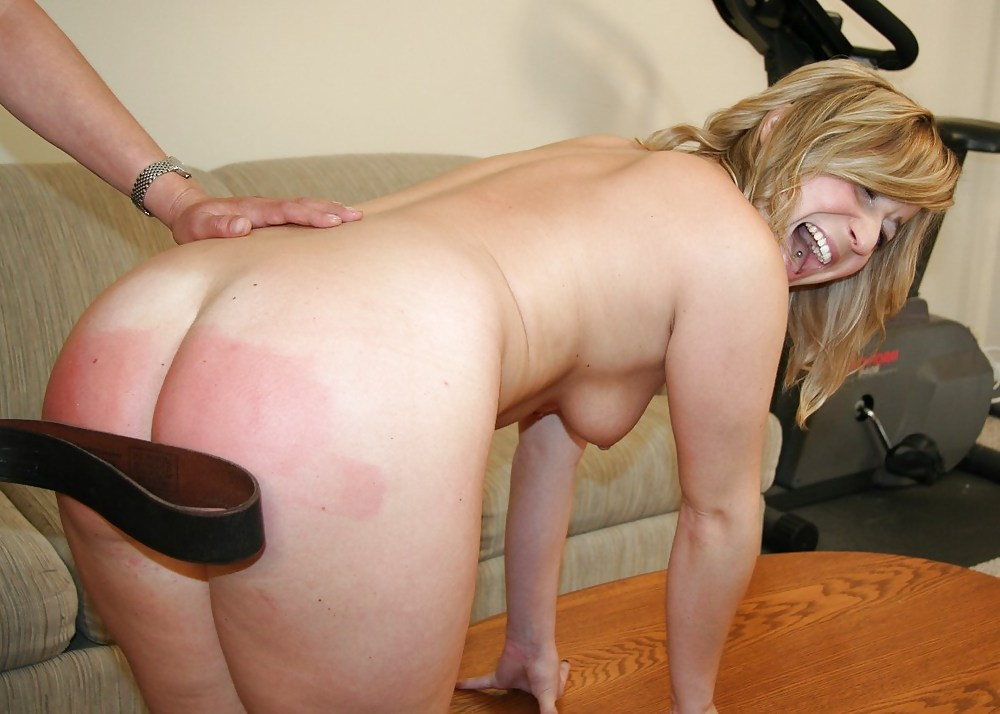 He is punishing his wife by spanking her bi
