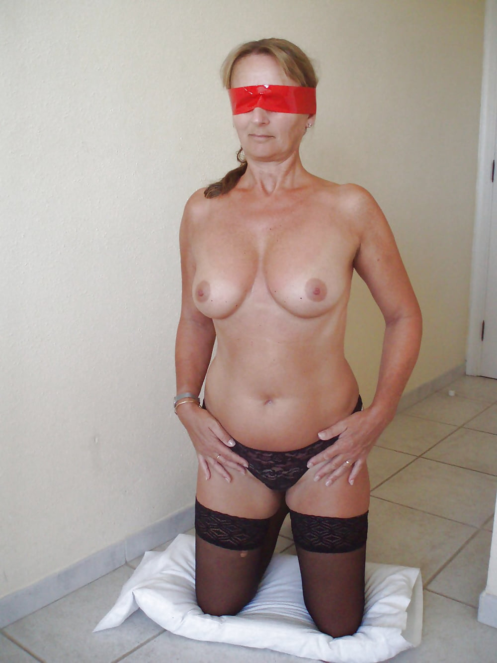 Redhead wife blindfolded tits ass