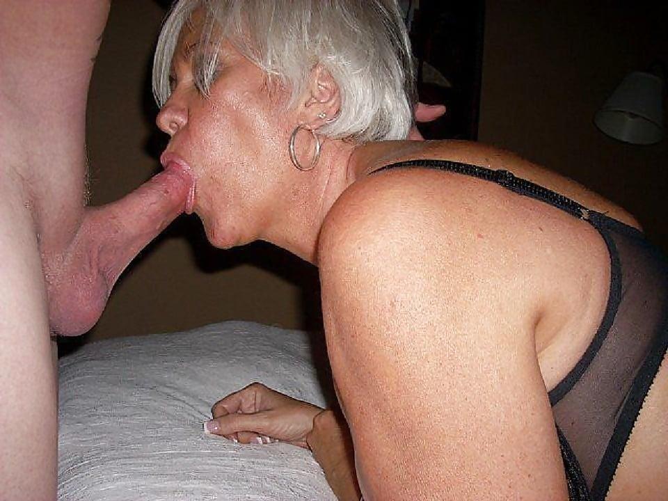 Hot mature slut sucking cock