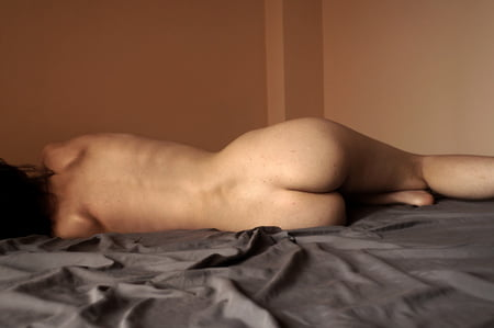 hairy girl naked in bed