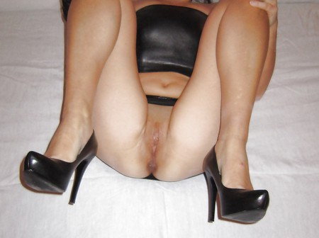 Wife on bed in leather hight heels and shaved pussy