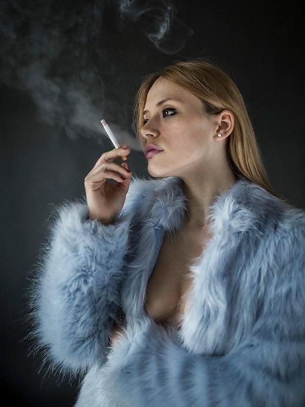 Milf Smoking A Cigarette While Fucking