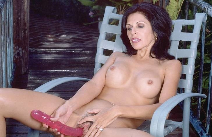 Mature woman with red double-ended dildo 2 - 9 Pics
