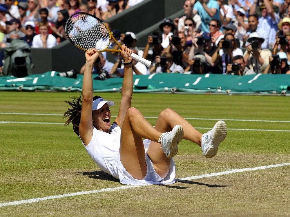 Sexy Female Tennis Player Posing On Stock Photo