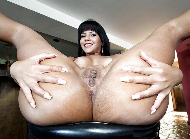 Girl teasing girl with dildo