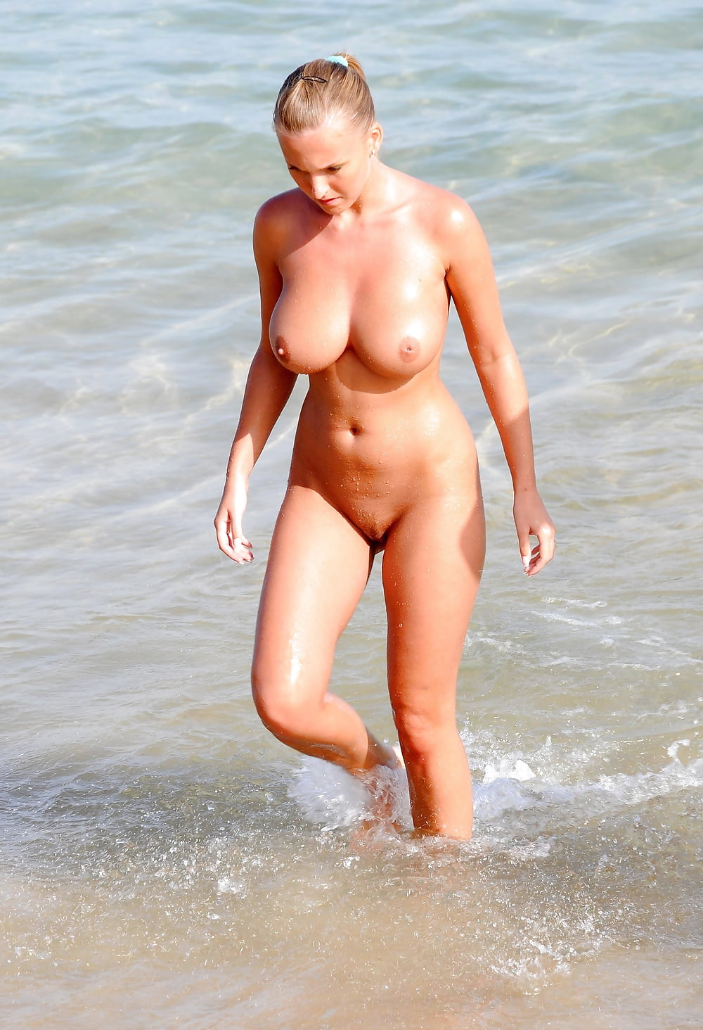 The bachelor's noni janur shows off her ample curves in a nude bikini