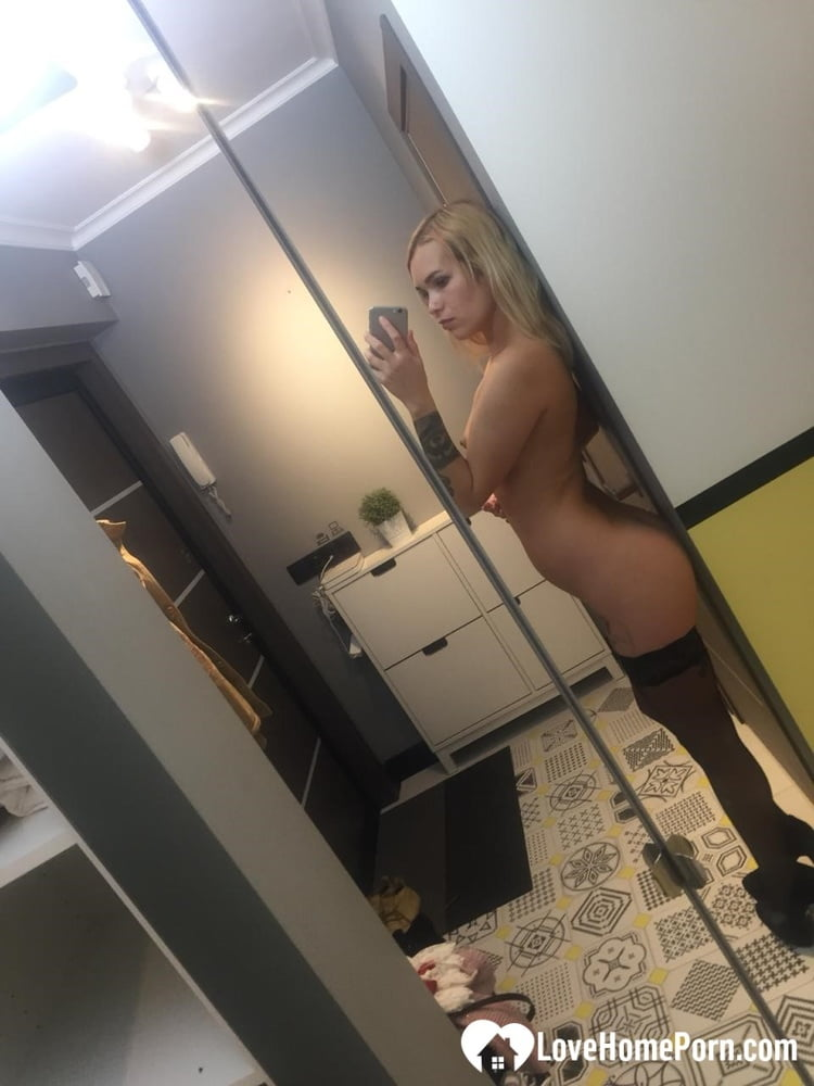 Hot blonde in stockings trying out high heels - 57 Pics