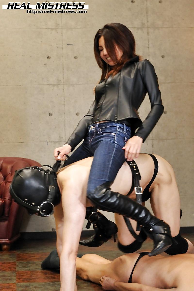 Mistress riding human pony