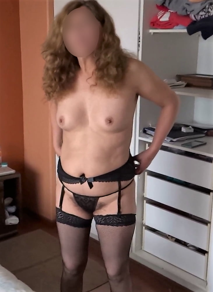My wife in lingerie, check out her videos too - 50 Pics
