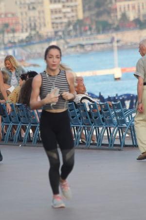 teen spandex running on beach