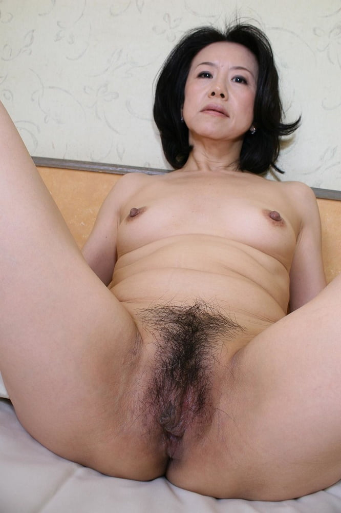 A skinny older asian adult female stock photo