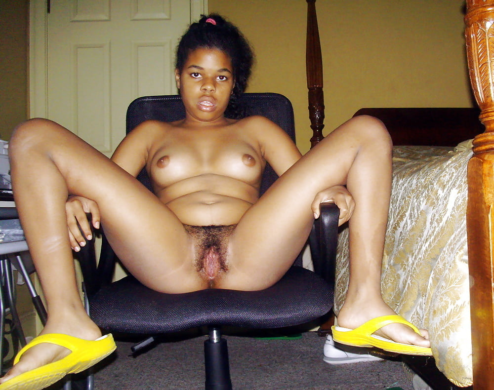 Saucy black webcam skank rubs her wet pussy and big tits