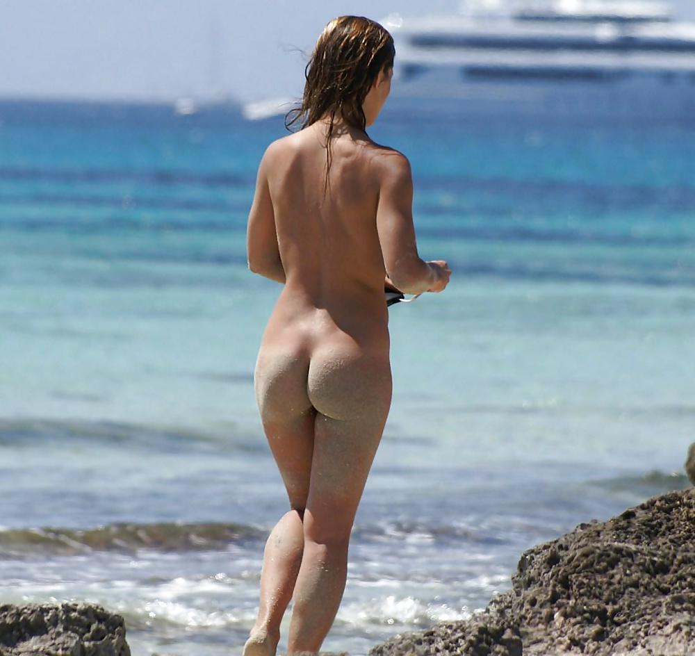 Embarrassed naked beach girl