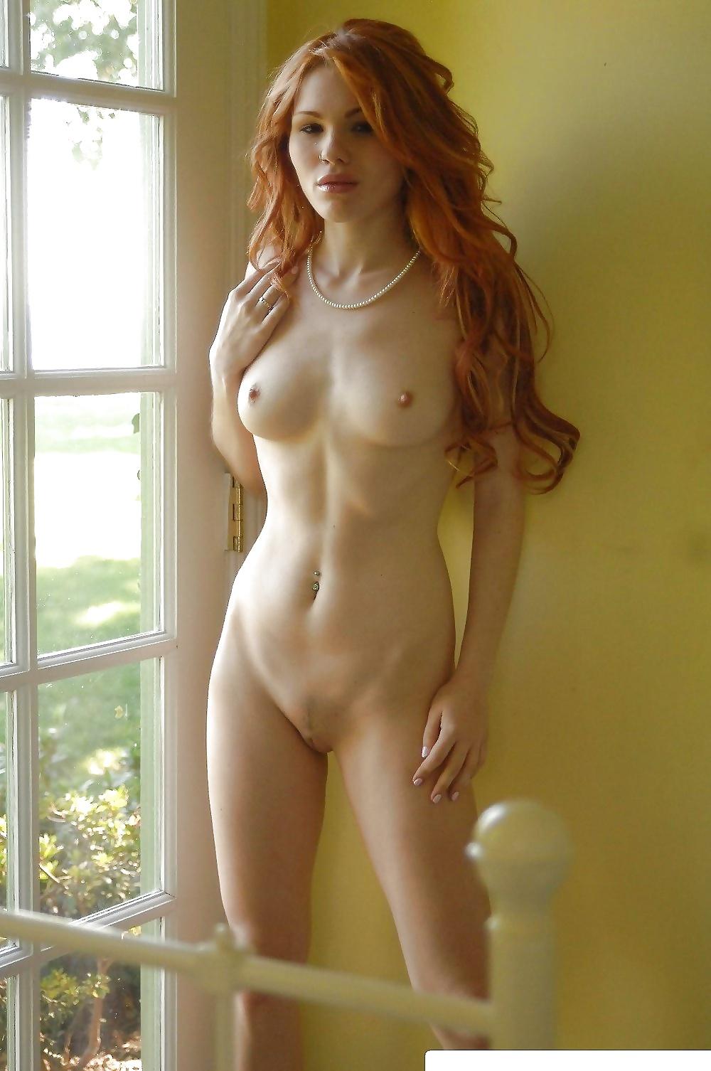 Nude redhead girl teasing on the floor