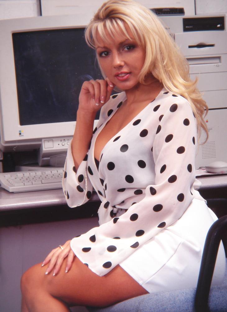 Busty office secretary