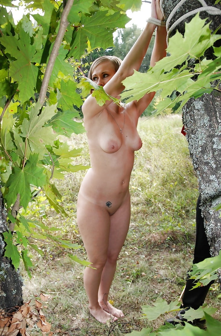 Naked girls tied to a tree fucking