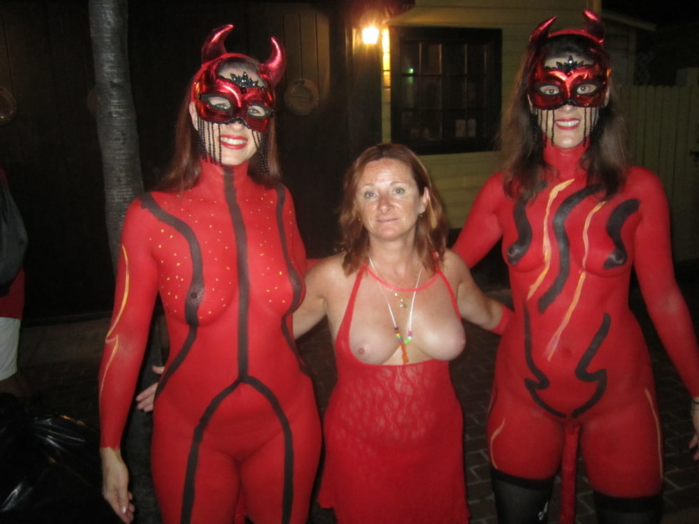 Flashing tits and pussy under her halloween costume