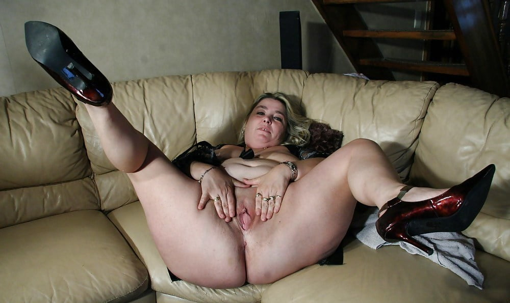 Ebony Bombshell With Thick Thighs Posing With Her Legs Spread