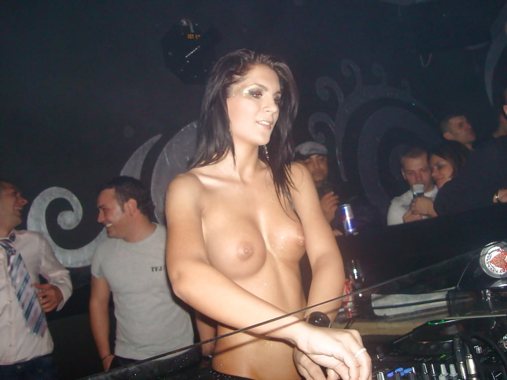 Nude dj playing music with her tits bouncing