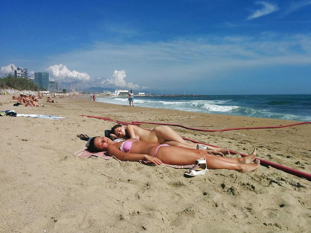 Naked guy on the public barceloneta beach in barcelona
