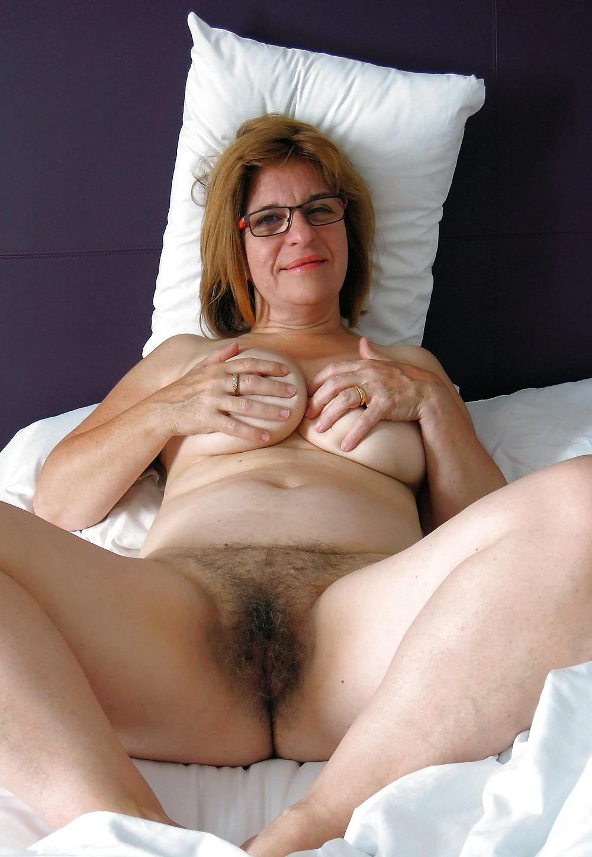 Man masturbates, ejaculates onto the back of a woman