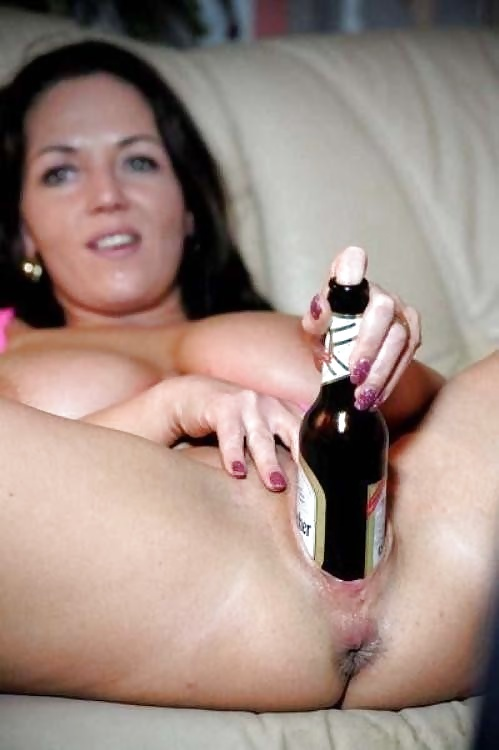 Nude women fucking themselves with bottles