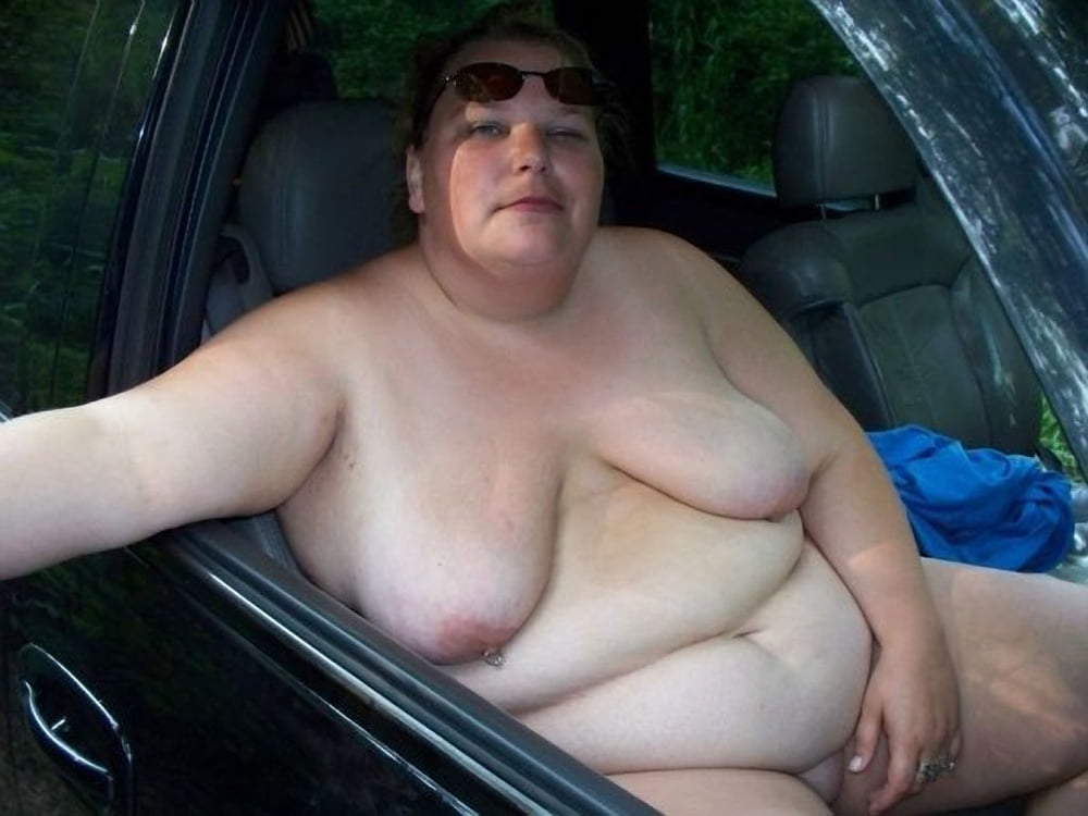 Naked Curvy Woman On The Front Of A Big Truck